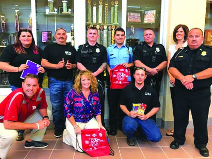 The Fraternal Order of Police #219, Beaver Local Education Association, Calcutta and Glenmoor fire departments, along with the Calcutta Walmart, raised more than $1,000 for school supplies for students in the Beaver Local School District, to be given out at the Back to School Bash Aug. 24. Representing the organizations are (kneeling, from left) Beaver Local Superintendent Eric Lowe; BLEA incoming President Kathy Beaver; Glenmoor Firefighter Jonathan Dear; (standing, from left) Glenmoor Firefighter Katie Utt, Glenmoor fire Lieutenant Cliff Utt, St. Clair Township Patrolman Keith Hilderbrand, Calcutta Firefighter Randy Schneider, St. Clair Township Patrolman Max Nolder, BLEA President Jill Riccardo and police Chief Brian McKenzie. (Photo by Jo Ann Bobby-Gilbert)