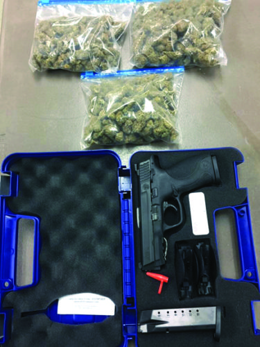 An estimated 240 grams of marijuana and a loaded .40-caliber pistol were seized by East Liverpool police after a traffic stop following a hit and run accident Wednesday night. (Photo courtesy of the East Liverpool Police Department