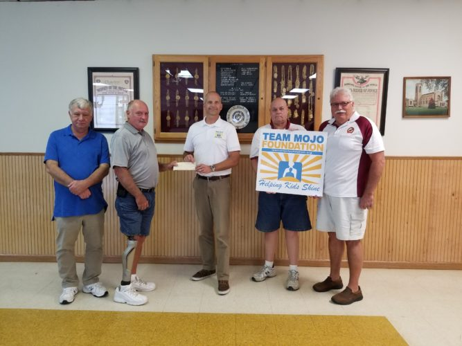 East Liverpool Moose Lodge 122 recently presented a donation to Team Mojo Foundation, a local nonprofit that helps underprivileged children in the Tri-State area. Pictured (from left) are Prelate Dick Plumley, Governor Bob Farnsworth, Team Mojo's Bill Crawford, Trustee Bob Woomer and Past Governor Bernie Williams. Moose lodges and chapters across the country donate over $75 million annually to their communities. (Submitted photo)