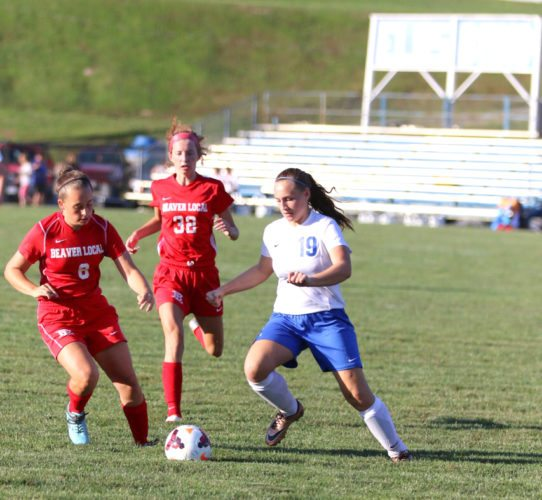 BeaverLocal's Madison Ours and Emily Monte close in on East Liverpool's Makenzie McKinnon on Friday at Patterson Field. Beaver Local won 8-1 courtesy of an attack that boasts nine returning starters. (Photo by Jimmy Joe Savage)