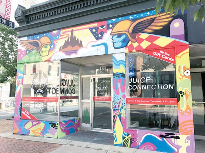 The owner of this vape shop in East Liverpool has been told by the city's Design Review Board he must cover this colorful hand-painted graphic and return the storefront to its original black color. (Photo by Jo Ann Bobby-Gilbert)