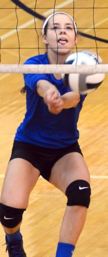 Lisbon's Izzy Perez bumps the ball against United on Tuesday at United Local High School. (Photo by Patti Schaeffer)