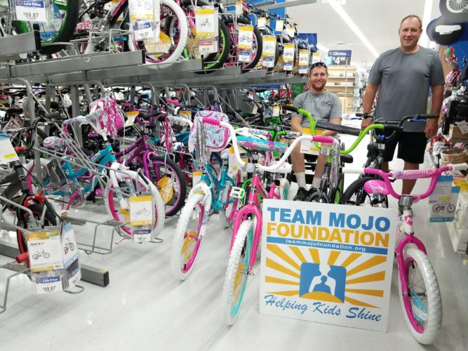 Cody Joseph (left) and Jeff Langdon, representing Team Mojo Foundation, select bicycles, purchased for local underprivileged kids, at Calcutta Walmart. Funds were raised earlier this year during an annual New Year's Day bike ride, where cyclists and other supporters pitched in. According to Team Mojo's Bill Crawford, the bikes were delivered to the Columbiana Metropolitan Housing Authority, who will find homes for them. For more information, including how to make a tax-deductible donation to Team Mojo Foundation, visit teammojofoundation.org or find them on Facebook. (Submitted photo)