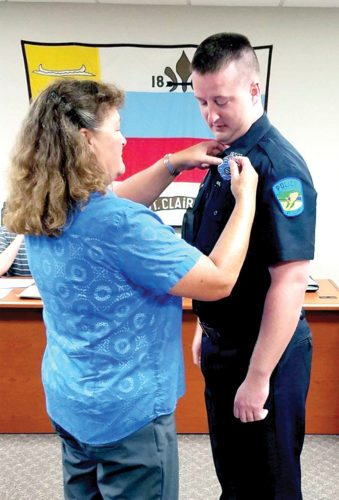 "St. Clair Township's newest patrolman, Blake Wilson of Hammondsville, was sworn in during Tuesday's township trustee meeting by Columbiana County Chief Prosecutor John Gamble. The new part-time officer's badge was pinned on by his mother, Tracy Gamble. Wilson completed the police academy at Eastern Gateway Community College in 2012, and served as a Jefferson County Sheriff's Department corrections officer from 2012-14. He also worked as a patrolman for the Saline Township Police Department from 2013 through the present. Chief Brian McKenzie said Wilson is currently the department's only part-time officer, with 12 full-time officers, including the chief, which he said is the same staffing level it was at prior to Chief Don Hyatt's retirement.  It is possible additional manpower will be hired, depending on ""how it plays out in the next couple of months,"" McKenzie said. (Submitted)"