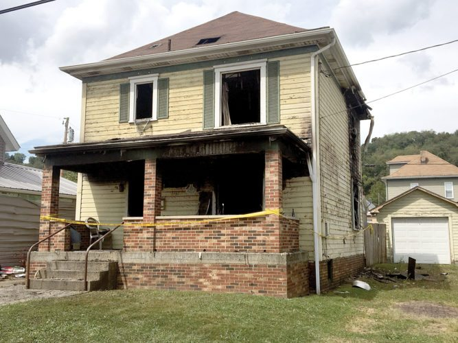 A fire ripped through this vacant home, 1737 Maple Ave., Wellsville, on Tuesday night. (Photo by Steve Rappach)