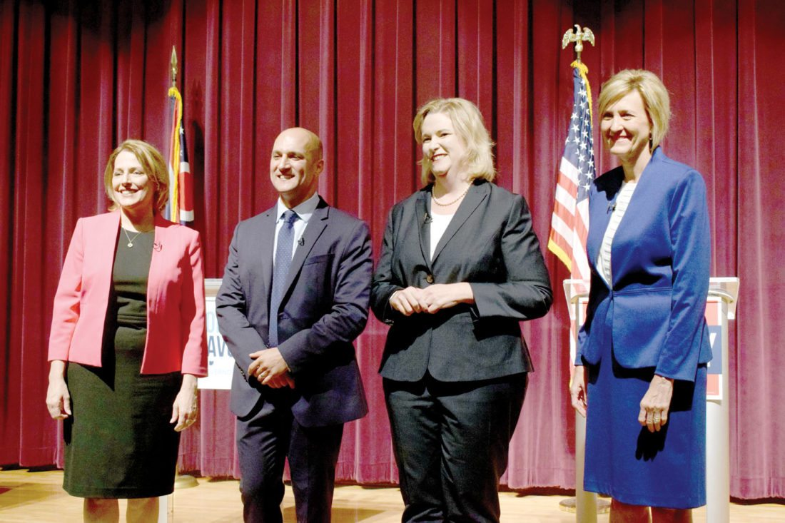 Ohio Democratic gubernatorial candidates posing for a photo at center stage after their first debate Tuesday at Martins Ferry High School, from left, are former state Rep. Connie Pillich; Ohio Sen. Joe Schiavoni, D-Boardman; Dayton Mayor Nan Whaley; and former U.S. Rep. Betty Sutton. (Photo by Scott McCloskey)