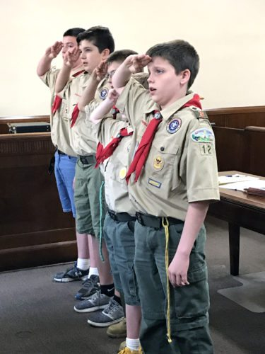 Members of Boy Scout Troop 12 led the Pledge of Allegiance to open Monday night's East Liverpool City Council meeting, also sitting in on the entire meeting. The Boy Scouts' participation was part of earning their Citizenship in the Community merit badge, according to assistant scoutmaster Jacob Rodgers. Saluting the flag are scouts (in no particular order) Barry Barton, Wesley Wedgewood, Kyle Rodgers, Trenton Wolfe and Keith Gamble. Also present, but not pictured, was Cade Karnosh. (Photo by Jo Ann Bobby-Gilbert)