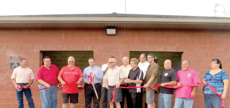Members of the Hancock County Parks and Recreations Board, along with county commissioners, cut the ribbon Friday evening to formally introduce the new concession stands and restrooms at the Gas Valley Sports Complex and Playgrounds in New Manchester during a special ceremony.(Photo by Steve Rappach)