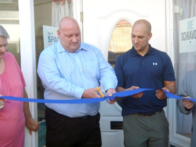 Columbiana County Democratic Party Chairman Nick Barborak (left) cuts the ribbon during Saturday's ceremony at the newly-remodeled party headquarters in Lisbon with assistance from  state Sen. Joe Schiavoni of Boardman. (Submitted photo)