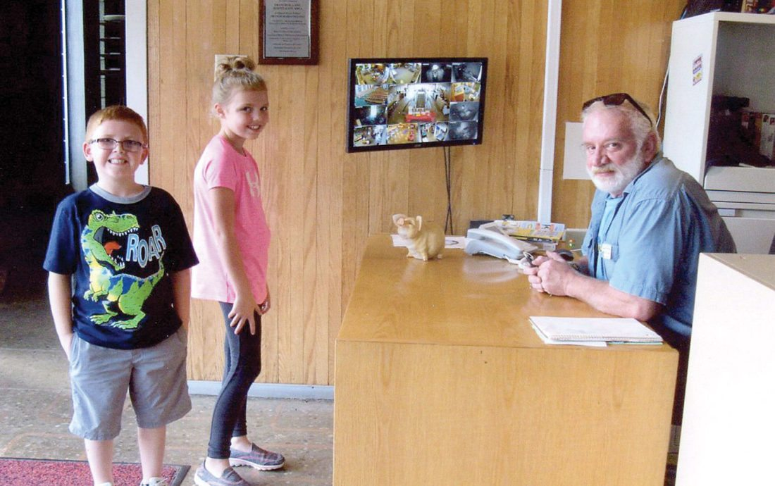 Don Jones (right) is a Hospitality Volunteer with the Center, and is shown here with two young patrons to the East Liverpool facility. (Submitted photo)