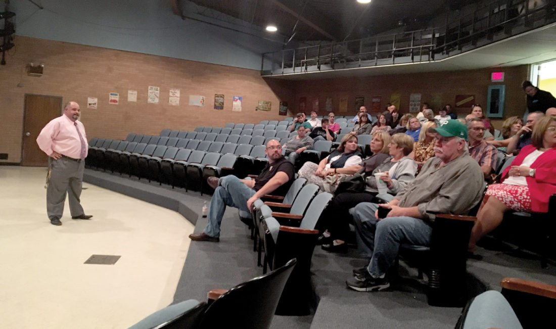 Hancock County Schools Superintendent Tim Woodward (standing) listens to a question in the audience of the Oak Glen High School Theatre during a Town Hall meeting held Wednesday. (Photo by Steve Rappach)