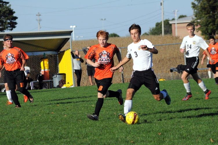 Wellsville's Eli Hays tries to get the ball from Crestview's Jeff Roberts during Tuesday's Div. III sectional opener at Crestview. Also shown is Crestview's Luke Wickline.