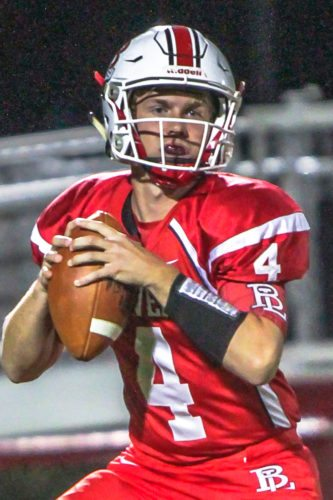Beaver Local's Luke Call looks to pass against Martins Ferry on Friday.