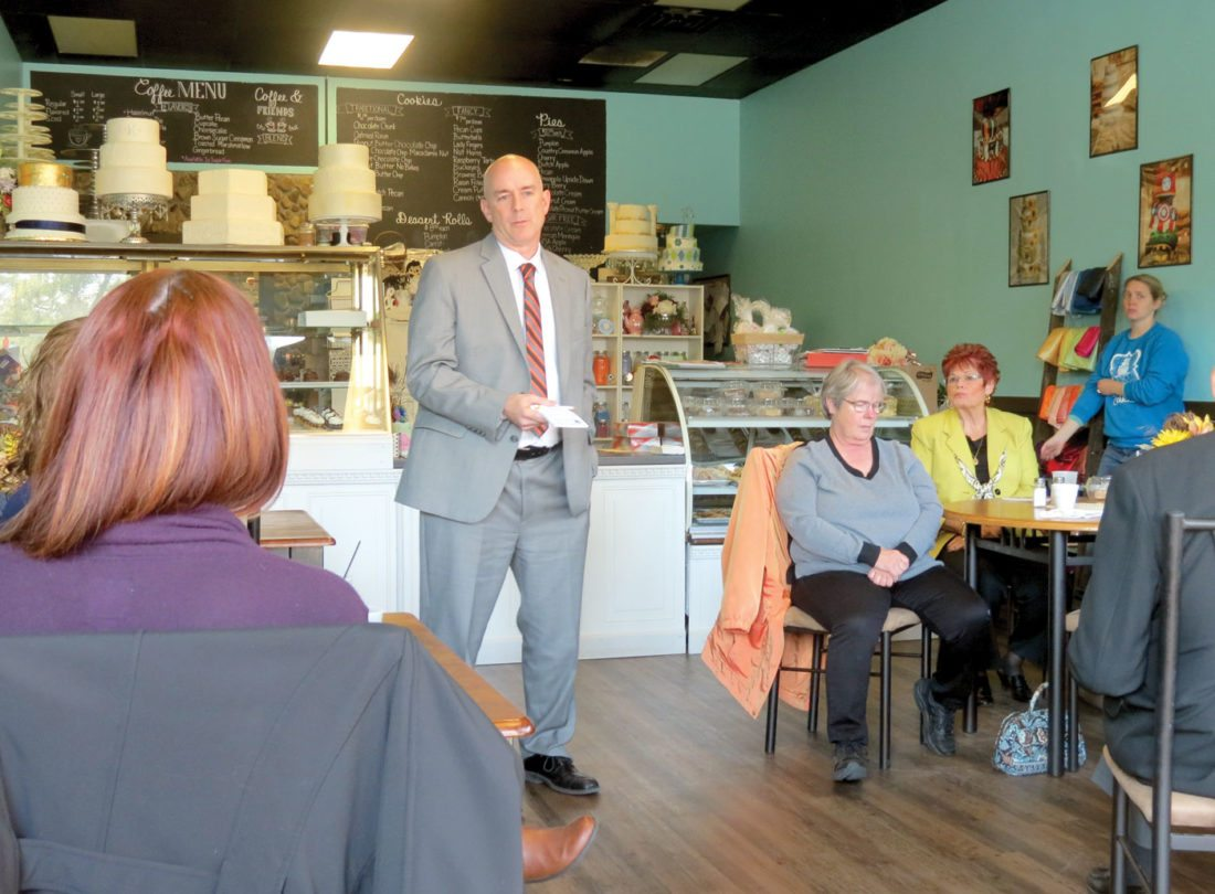 Daw Elementary principal Burt Stellers addressed attendees of the Wellsville Area Chamber of Commerce's October luncheon on Thursday at Simply Sweet Cakes on Main Street. (Photo by Steve Rappach)