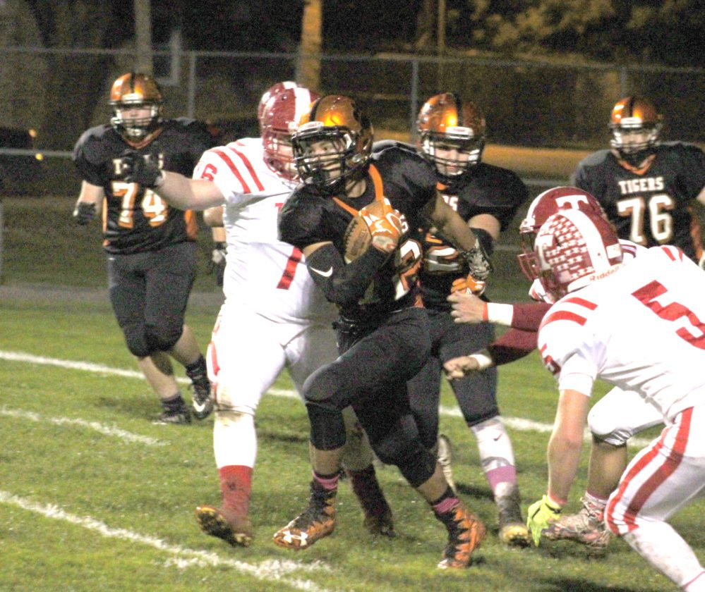 Wellsville's Derrick Suggs runs the ball against Toronto on Friday night.