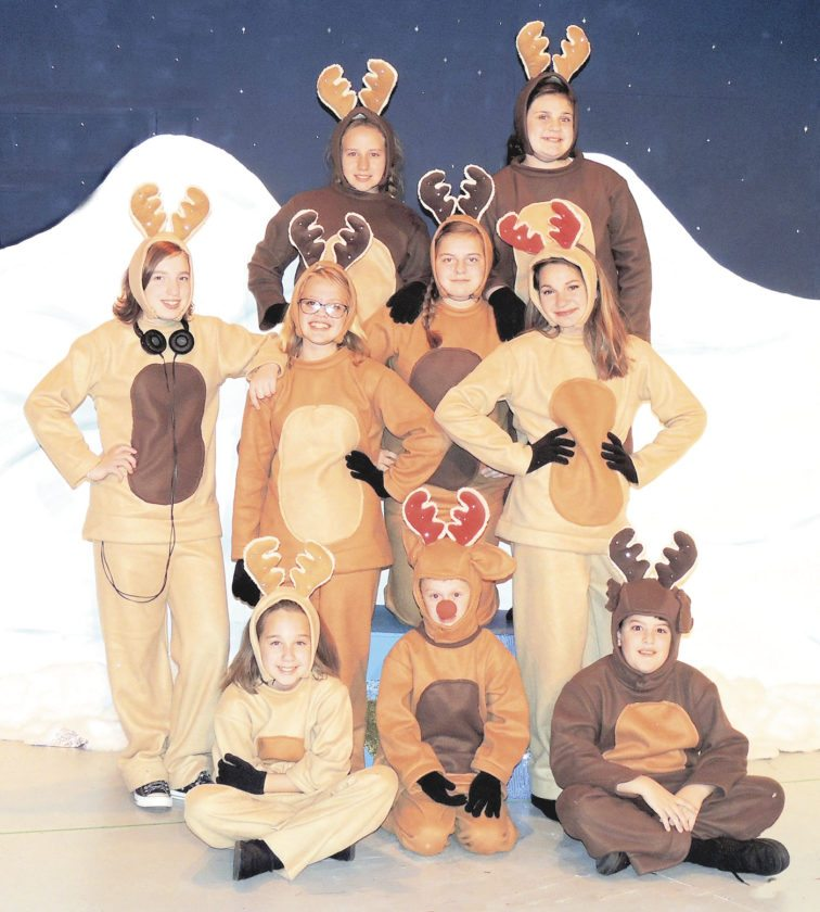 "Rudolph (Adam Looman of Hanoverton) and Santa's ""Mighty Eight"" pose for a publicity shot before their midnight ride. Pictured are (bottom row, from left) Isabella Cornwell of Lisbon, Rudolph, and Marshall Hall of Lisbon; (middle) Angela McCracken and Erin Ryan, both of Salem, and Jenna Ebert and Destiny Gray, both of Lisbon; and (top) Katie Dees of Hanoverton and Mara Householder. (Submitted photo)"