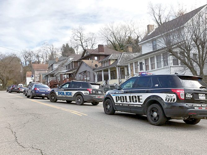 Police cruisers from three jurisdictions lined Bradshaw Avenue in East Liverpool Friday morning as officers assisted the county drug task force in searching a house where a Toronto woman alleged she purchased drugs the previous day. (Photo by Jo Ann Bobby-Gilbert)