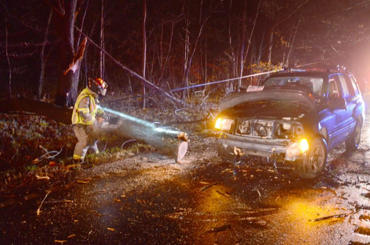 Two vehicles struck a downed tree along state Route 7 south, in Middleton Township, during Saturday's rainstorm. Alicia Connolly of Poland was taken by New Waterford Fire/EMS to St. Elizabeth's in Boardman after her Geo Tracker struck the tree. Brooke Murphy, 16, of Negley did the same in her Nissan Rogue, although the teenager was not injured. Sgt. Adam Shonk of the Lisbon Post of the State Highway Patrol and New Waterford firefighters responded to the scene. (Photo by Patti Schaeffer)