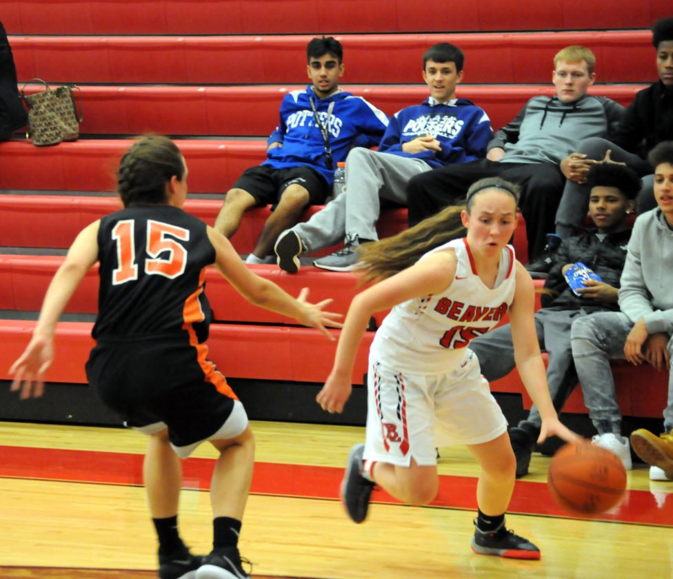 Beaver Local's Kierra Taylor drives to the basket past Wellsville's Cameron Carlavale on Monday at Beaver Local.