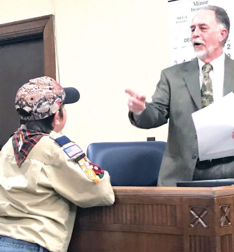 Cub Scout Tyler Howard receives some advice from East Liverpool President of Council John Torma after the council meeting Monday night. (Photo by Jo Ann Bobby-Gilbert)