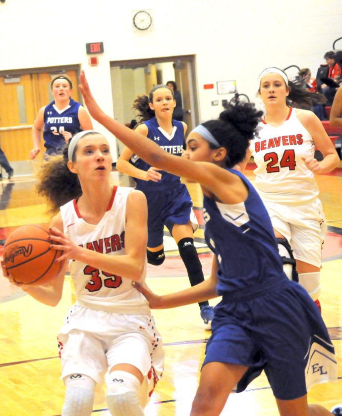 Beaver Local's Emily Monte goes for the shot as East Liverpool's Darshay Foster defends on Monday night.