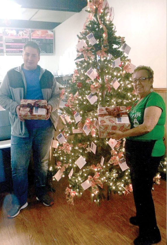 Pictured, Justin DeVore and Virginia Carpenter are shown with some of the already donated gifts. (Submitted photo)