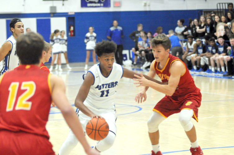 East Liverpool's Tre Jackson looks to get past Indian Creek's Austin Yaich on Friday night at Potter Fieldhouse.