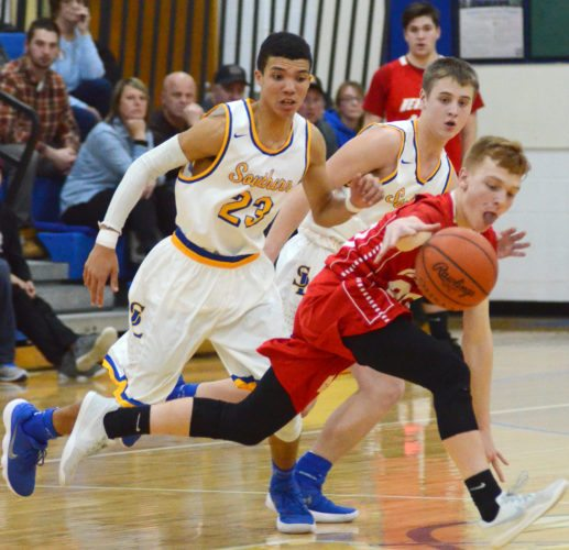Heritage Kenneth Martin is guarded by Southern's Jayce Sloan and Cameron Grodhaus.