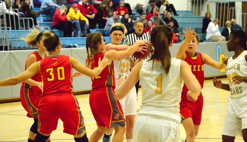 Oak Glen's Emmy Severs battles for a rebound with Indian Creek's Ashley Yaich on Thursday at Oak Glen High School. (Photo by Joe Catullo)