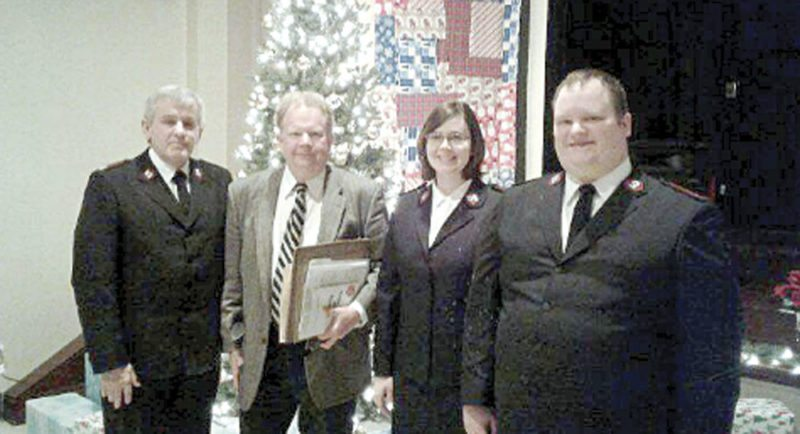 Pictured (from left) are Major James Guest from The Salvation Army Divisional Headquarters in Cleveland, local attorney Timothy Brookes, and the new officers of the East Liverpool Salvation Army, Lieutenant Lydia Behr and Lieutenant Andrew Behr. (Submitted photo)