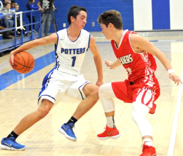 East Liverpool's Brennan O'Hara tries to dribble around Beaver Local's Drew Theiss on Friday night.