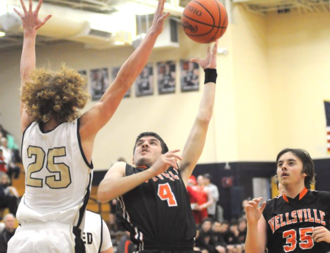 Wellsville's Garrett Scott shoots over United's Landon Baker during Tuesday's game at United.