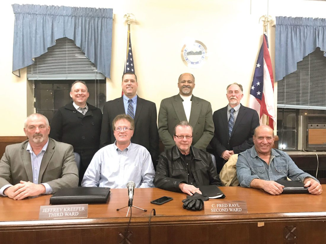 Posing for a photo during the first meeting of the year are East Liverpool City Council members (seated, from left): 4th Ward Scott Barrett; 3rd Ward Jeff Kreefer; 2nd Ward Fred Rayl; 1st Ward Ray Perorazio; (standing, from left) council-at-large John Mercer; Brian Kerr; and Ernest Peachey; and President of Council John Torma. (Photo by Jo Ann Bobby-Gilbert)