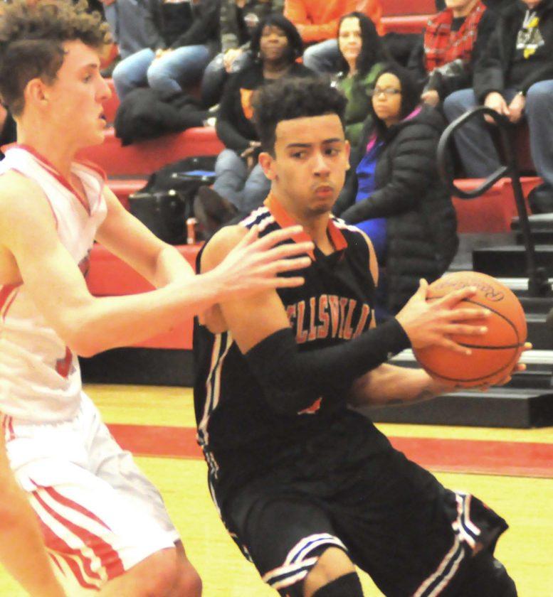 Wellsville's Cameron Davis looks to pass as Beaver Local's Jaden Kiddey defends on Tuesday.