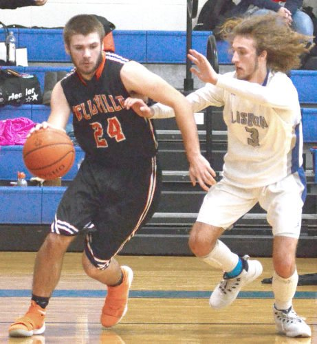 Wellsville's Brandon Patterson (24) drives around Lisbon's Grant Frederick during Friday's game.