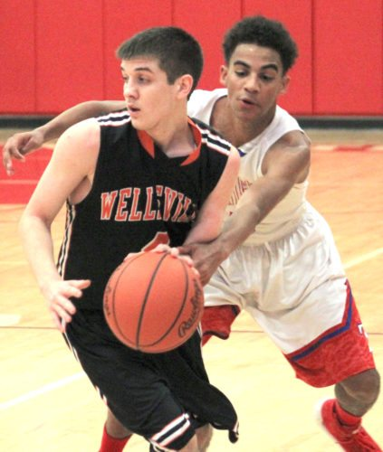 Toronto's Trillion West tries to steal the ball from Wellsville's Garrett Scott during Tuesday's game at Toronto.