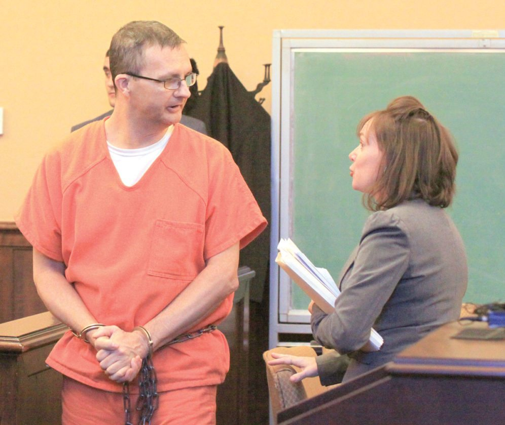 Terry Brown speaks with his defense attorney Jennifer Gorby following his hearing in Columbiana County Common Pleas Court on Jan. 5. (Photo by Deanne Johnson)