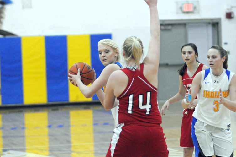 Southern's Hayleigh Allen looks to pass as Columbiana's Marisa McDonough defends on Thursday.