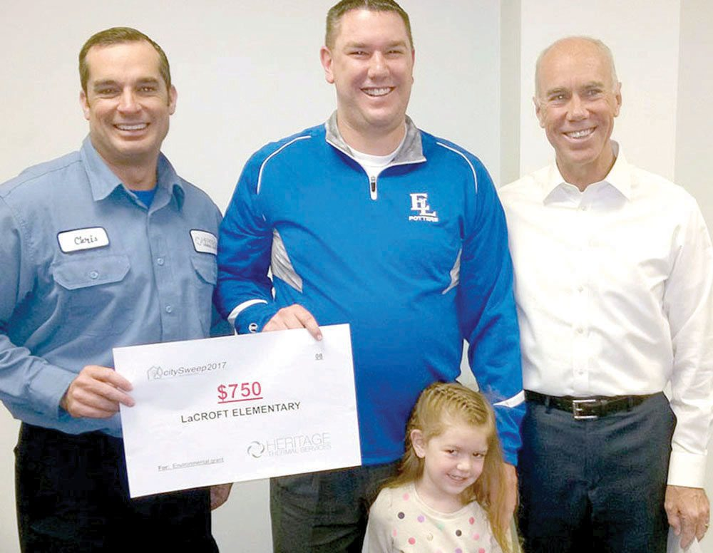 An environmental grant used to establish a recycling program at LaCroft Elementary School was presented in 2017 to Principal Jake Walgate (center) by Heritage Thermal Services President (left) Christopher T. Pherson and Ohio Rep. Tim Ginter. Applications are now being accepted for 2018 grants. (Submitted photo)