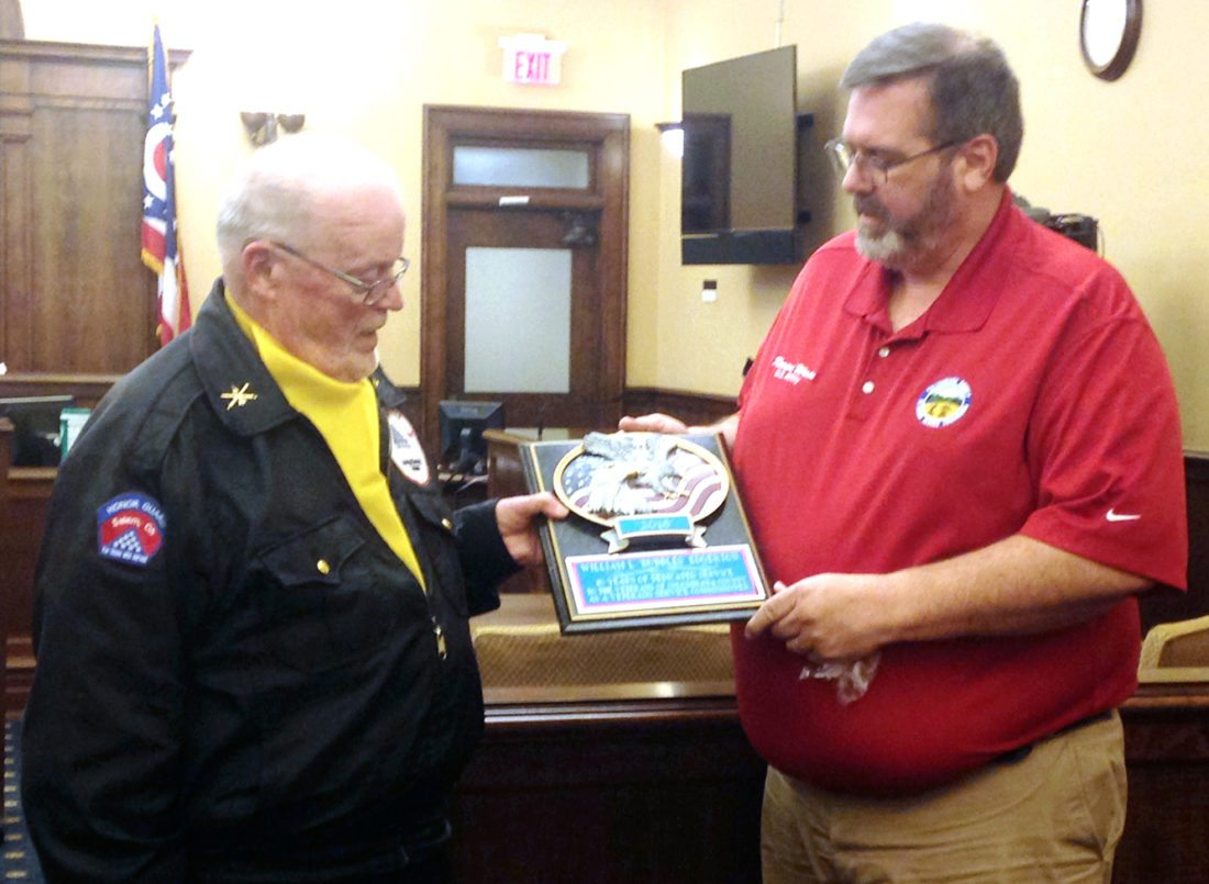 William Edgerton (left) was presented an award from senior service officer Kevan Wain after Edgerton completed two terms (10 years) as the Amvets representative to the Columbiana County Veterans Service Commission. (Photo by Deanne Johnson)