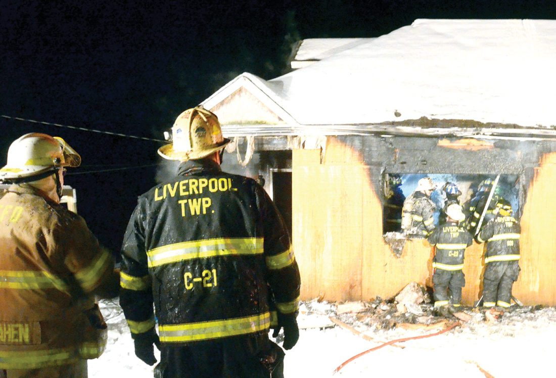 Liverpool Township stations 7 and 8 firefighters converged on a house found engulfed in flames at 1107 Anderson Boulevard, before midnight Friday. No one was home at the time of the fire, and Fire Chief Dave Ward is investigating the cause of the blaze. (Photo by Patti Schaeffer)