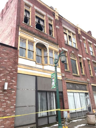 Caution tape steers pedestrians away from this Sixth Street building in East Liverpool after glass fell from upper story windows, resulting in city officials having firefighters remove glass from other windows. (Photo by Jo Ann Bobby-Gilbert)