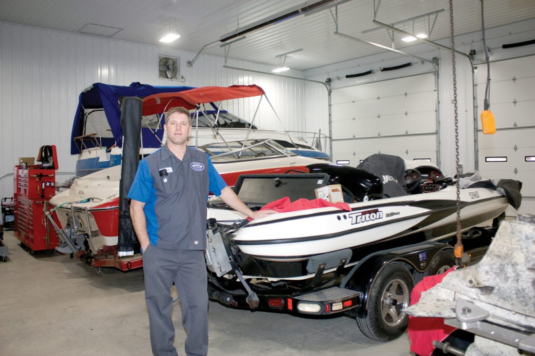 Jason Moore, owner of Superior Marine Services in Calcutta, stands in the shop area of his new business that opened in September 2017. The business focuses on servicing and repairing stern drive and outboard marine motors. Superior Marine is certified to repair Mercury, Volvo Penta and Tohatsu motors. (Photo by Larry Claypool)