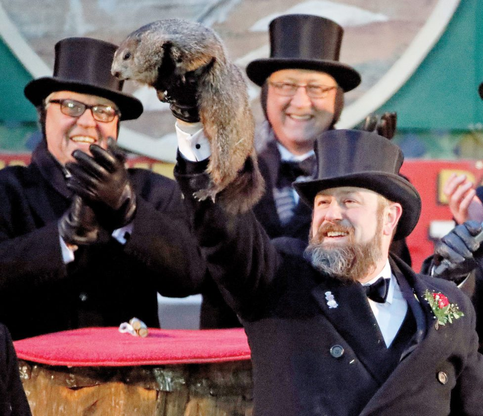 Groundhog Club  co-handler Al Dereume holds Punxsutawney  Phil, the weather  prognosticating groundhog,  during the 132nd  celebration of Groundhog Day on Gobbler's Knob in Punxsutawney, Pa., Friday. Phil's  handlers said that the groundhog has forecast six more weeks of winter weather. (AP Photo/ Gene J. Puskar)
