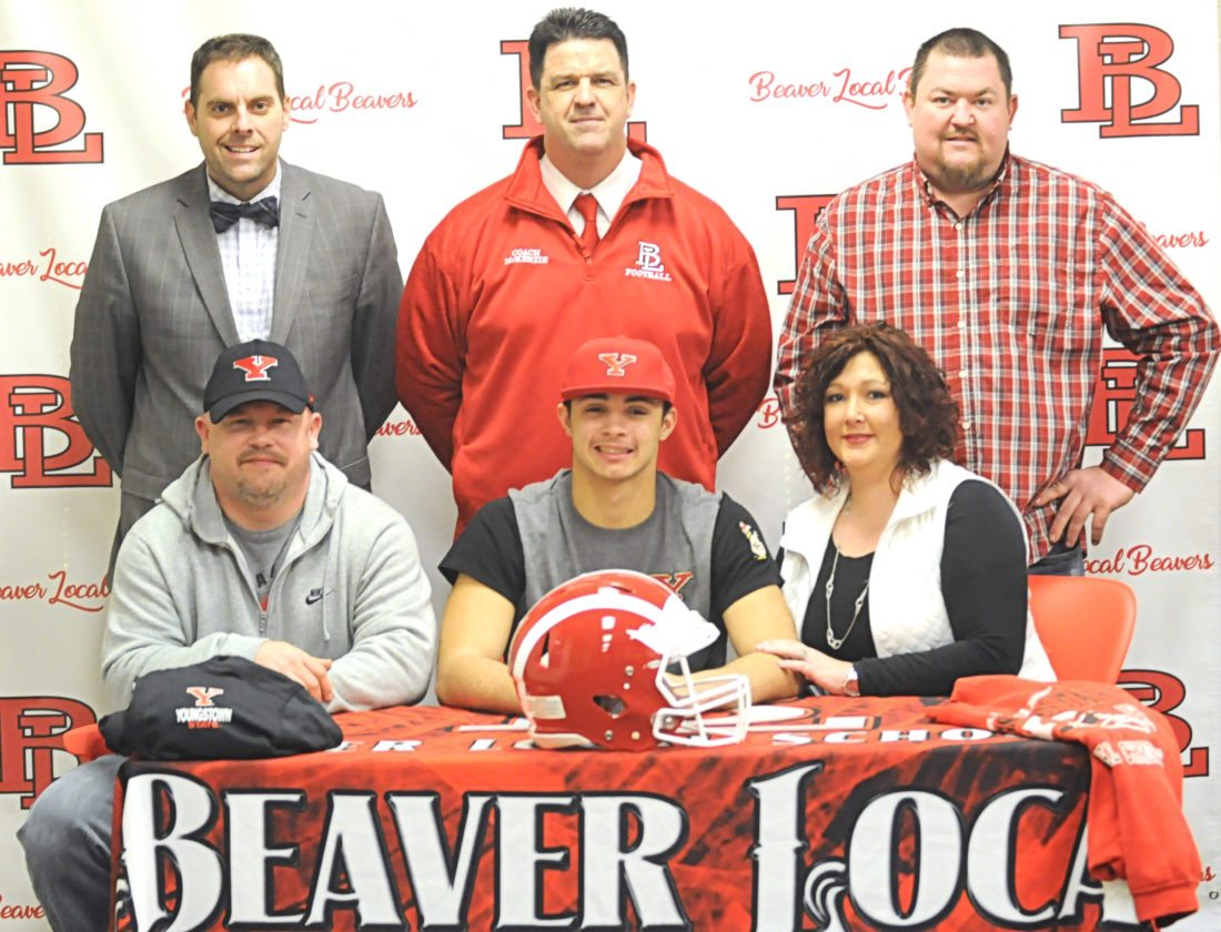 Beaver Local football standout Michael Clendenning recently announced his intention to become a walk-on with the Youngstown State University football team. Seated with Michael are his father Rich Clendenning and mother Victoria Schneider. Standing (from left) are Beaver Local superintendent Eric Lowe, Beaver Local football coach Mike McKenzie and stepfather Chad Schneider.