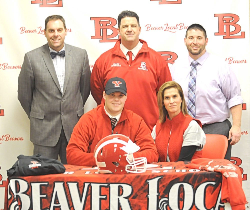 Beaver Local football standout Zach Thomas recently announced his intention to become a walk-on with the Youngstown State University football team. Seated with Zach is his mother Kara Thomas. Standing (from left) are Beaver Local superintendent Eric Lowe, Beaver Local football coach Mike McKenzie and Beaver Local athletic director Rick Prescott.