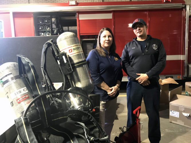 Shown with some of the new equipment are EMA Director Peggy Clark (left) and East Liverpool city firefighter Antony Cumo. (Photo by Jo Ann Bobby-Gilbert)