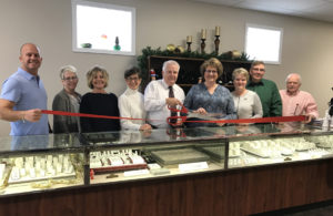 The Columbiana Area Chamber of Commerce welcomed Regal Jewelers into their newly renovated building at 246 E. Park Ave. with a red ribbon cutting ceremony on Thursday. From left, Rob Schwartz, Chamber director; Penny DeJong, Regal Jewelers employee; Janice Attle, Regal Jewelers employee; Ginny Perkins, Chamber director; Tom Dorn, owner; Julie Dorn, owner; Chris Davis, Chamber director; Rick Noel, City of Columbiana councilman; Larry Deidrick, Chamber director. (Submitted photo)