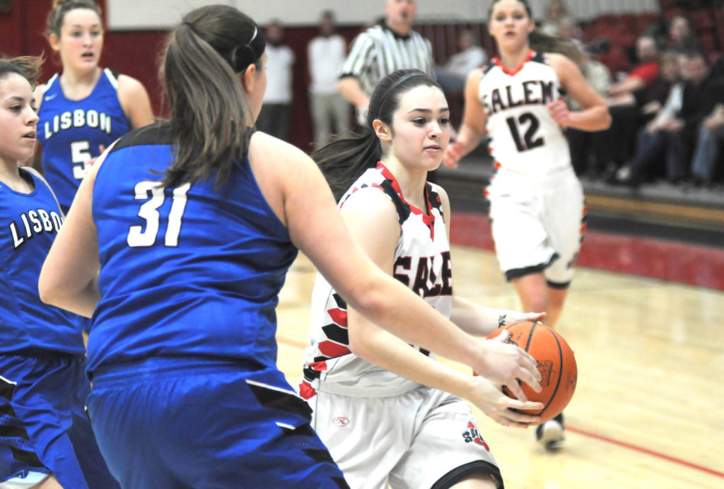 Salem's Elly Exline drives past Lisbon's Mackenzie Mason while Ellie Davidson (12) watches on Wednesday. (Salem News/Chris Rambo)