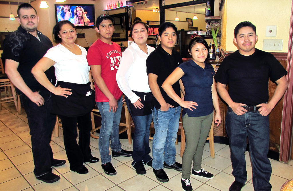 "The Rancho Viejo family restaurant opened two weeks ago at 377 S. Ellsworth Ave. offering ""food cooked differently"" along with a bar with domestic and foreign beers. The staff  of Rancho Viejo includes, from left, Mario Curiet, chef; and servers Carmelina Huerta, Daiel Marcos, Claudia Cuellar, Abraham Manuel, Destiny M. Velo and Jose Marcos. Rancho Viejo changes food specials every day and offers booth or open table dining. (Salem News photo Larry Shields)"